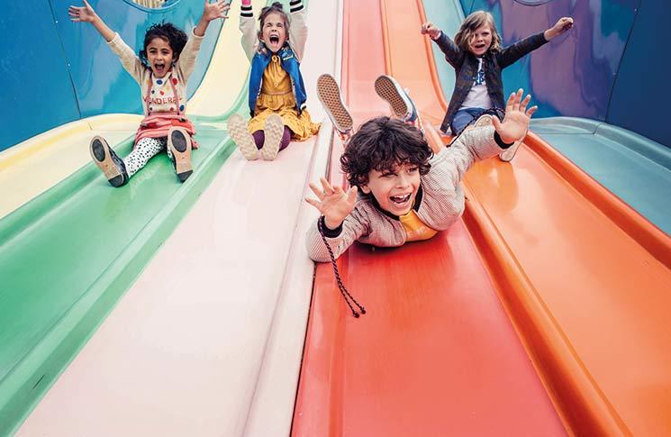 Kids sliding down slide