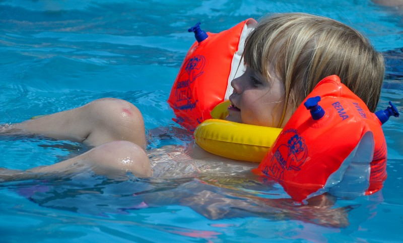 backfloating with arm bands childrens swimming lessons