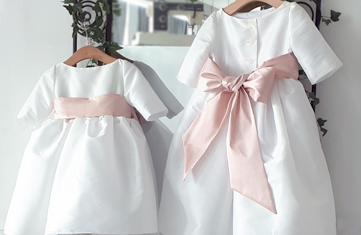 claire-white-and-pink-flower-girl-dress-little-eglantine