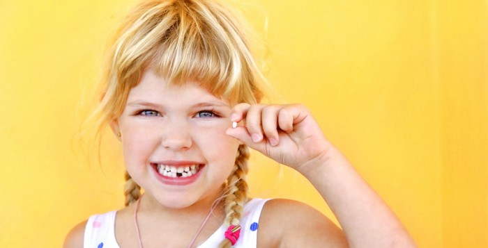 Girl holding tooth